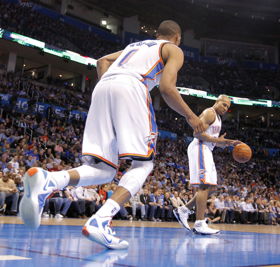 Oklahoma City Thunder point guard Russell Westbrook (0) inbounds the ball to teammate Derek Fisher (37) during the NBA basketball game between the Oklahoma City Thunder and the Los Angeles Clippers at Chesapeake Energy Arena on Wednesday, March 21, 2012 in Oklahoma City, Okla.  Photo by Chris Landsberger, The Oklahoman