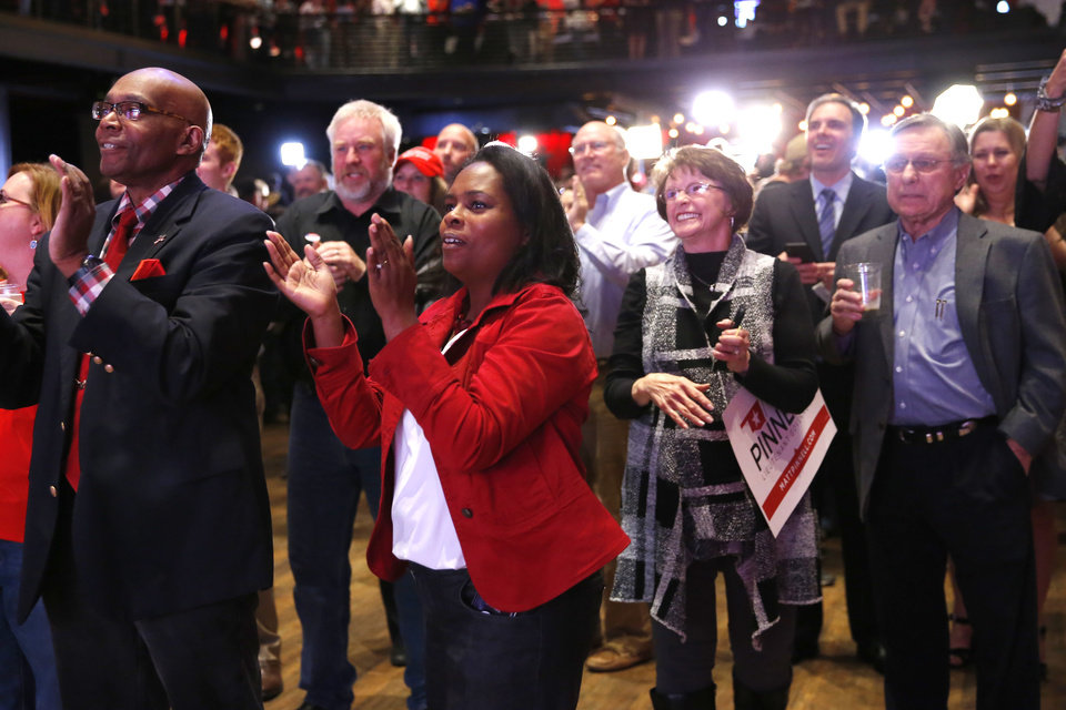 Photo - Raphala Taylor of Norman cheers during the Republican election night watch party for the 2018 elections at the Bricktown Events Center in Oklahoma City, Nov. 6, 2018. Photo by Bryan Terry, The Oklahoman