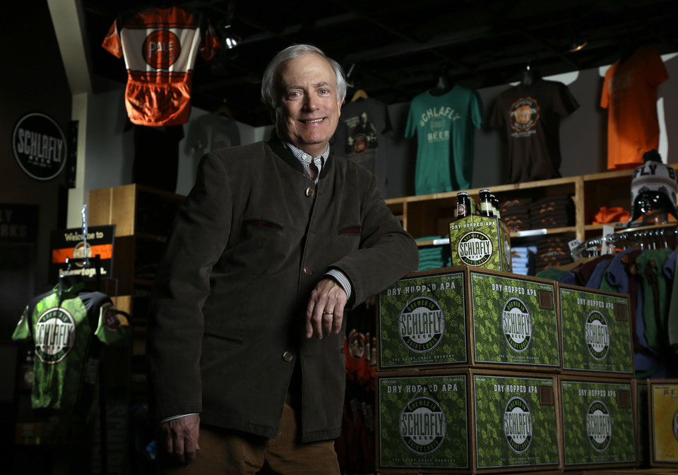 Photo - Tom Schlafly, co-founder of the brewery which produces the Schlafly brand of beers, poses for a photo inside the gift shop at Schlafly Bottleworks on Wednesday, March 12, 2014, in Maplewood, Mo. Schlafly has been in a trademark dispute with his aunt, conservative activist Phyllis Schlafly, over whether Schlafly is primarily a last name or a commercial brand that deserves legal protection. (AP Photo/Jeff Roberson)