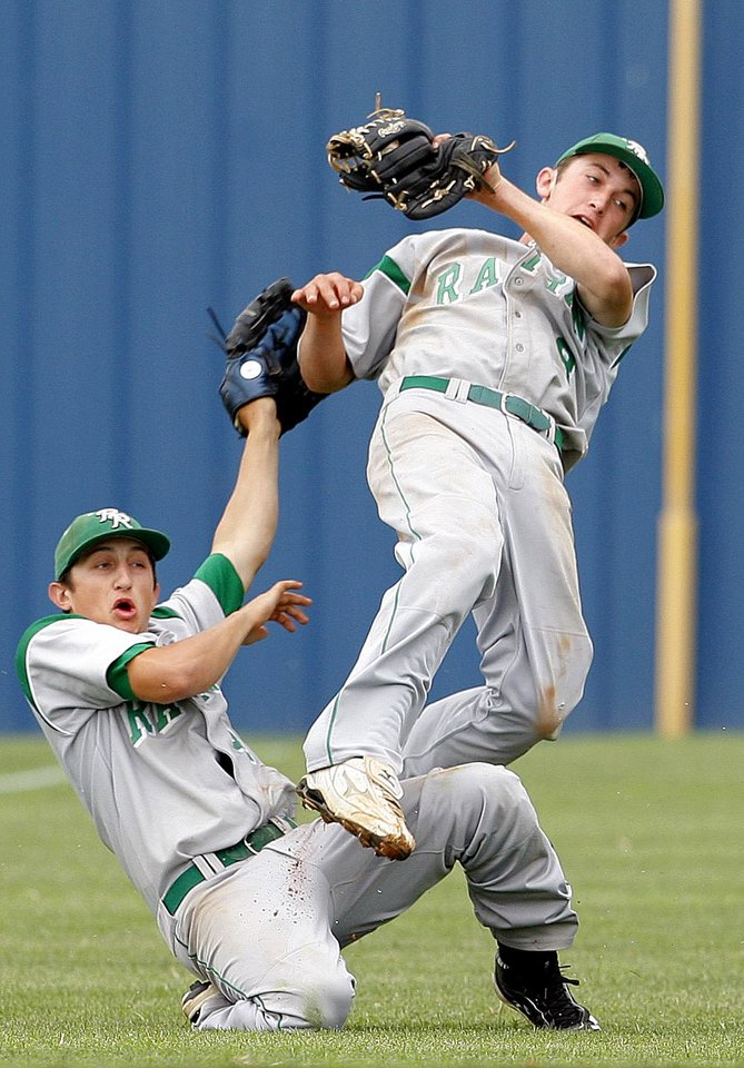 Rattan's Blake Watts, right, runs into AJ Davis after making a catch during Friday's Class A baseball state tournament game against Pioneer at Dolese Park.  Photo by Sarah Phipps, The Oklahoman