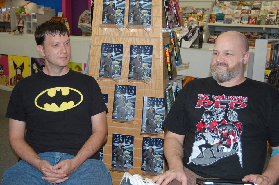 "Jackson Compton, left, and Jerry Bennett discuss their comic book series ""Nadir's Zenith"" at a local comic-book store.  Photo by Annette Price, for The Oklahoman <strong></strong>"