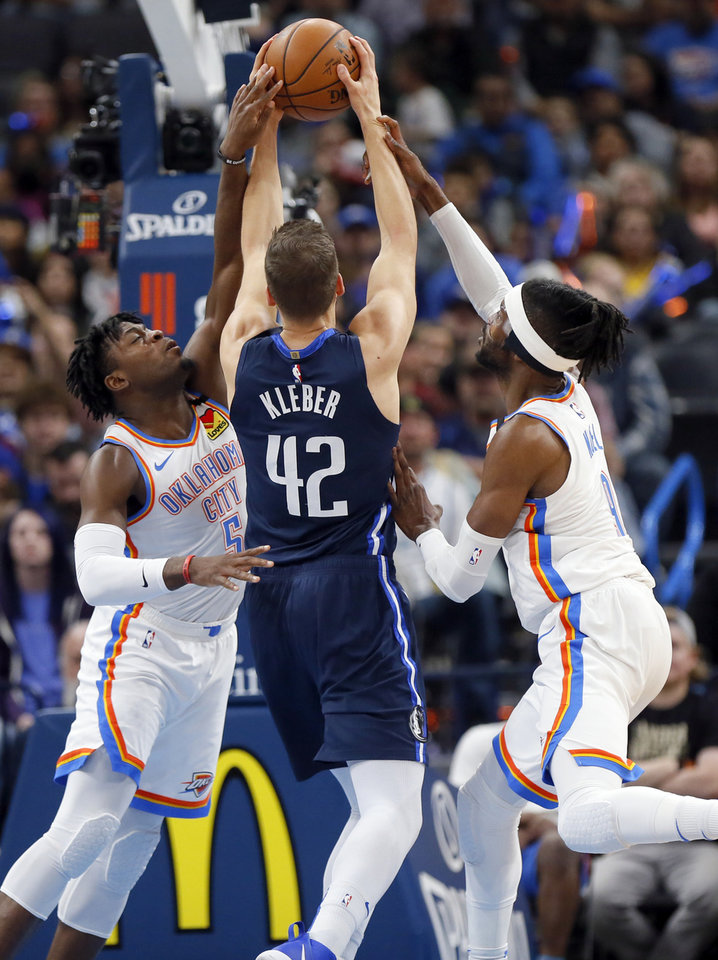 Photo - Oklahoma City's Luguentz Dort (5), left, and Nerlens Noel (9) defend Dallas' Maxi Kleber (42) during an NBA basketball game between the Oklahoma City Thunder and Dallas Mavericks at Chesapeake Energy Arena in Oklahoma City, Monday, Jan. 27, 2020. [Nate Billings/The Oklahoman]