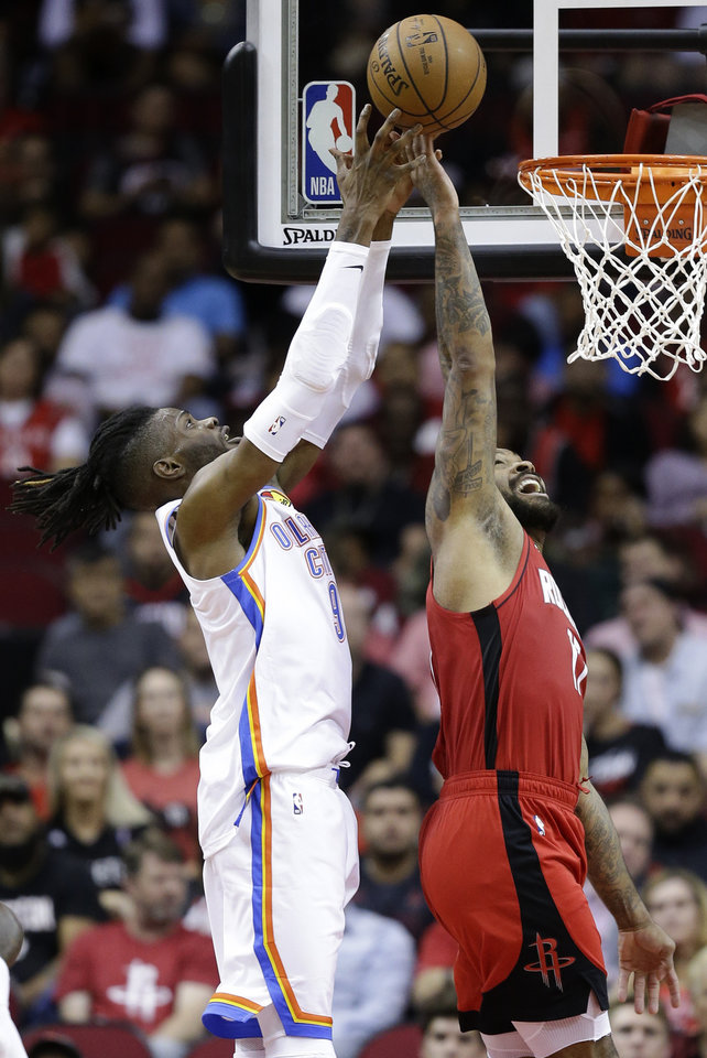 Photo - Oklahoma City Thunder forward Nerlens Noel, left, and Houston Rockets forward PJ Tucker vie for a rebound during the first half of an NBA basketball game, Monday, Oct. 28, 2019, in Houston. (AP Photo/Eric Christian Smith)
