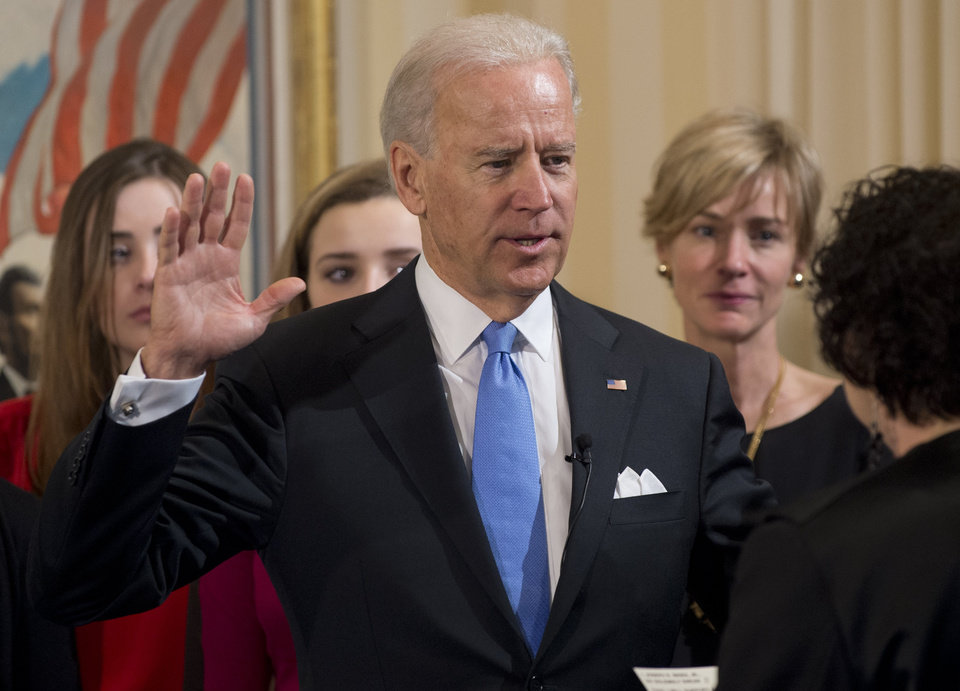 Vice President Joe Biden takes the oath of office during the 57th Presidential Inauguration official swearing-in ceremony at the Naval Observatory on Sunday, January 20, 2013 in Washington. The oath is administered by US Supreme Court Justice Sonia Sotomayor.   (AP Photo/Saul Loeb, AFP)