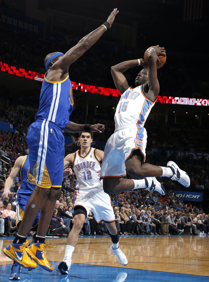 Photo - Oklahoma City's Reggie Jackson (15) shoots a lay up as Golden State's Jermaine O'Neal (7)  during the NBA game between the Oklahoma City Thunder and the Golden State Warriors at the Chesapeake Energy Arena, Friday, Nov. 29, 2013. Photo by Sarah Phipps, The Oklahoman