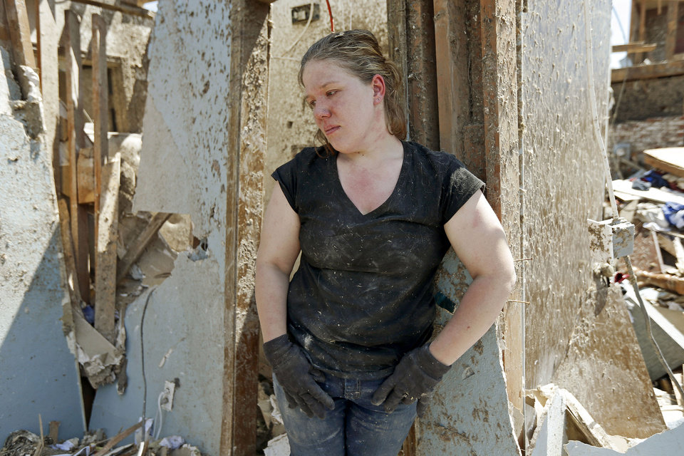 Photo - Sarah Patteson stands by the spot where she and her two children took shelter as the tornado hit their house on Kings Manor on Wednesday, May 22, 2013. A tornado damage the are on Monday, May 20, 2013. Photo by Bryan Terry, The Oklahoman