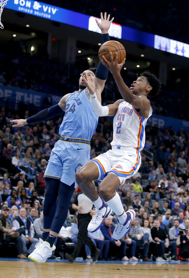 Photo - Oklahoma City's Shai Gilgeous-Alexander (2) goes the basket as Memphis' Dillon Brooks (24) defends during the NBA game between the Oklahoma City Thunder and the Memphis Grizzlies at the Chesapeake Energy Arena in Oklahoma City, Thursday, Dec. 26, 2019.  Oklahoma City loss to Memphis 110-97. [Sarah Phipps/The Oklahoman]