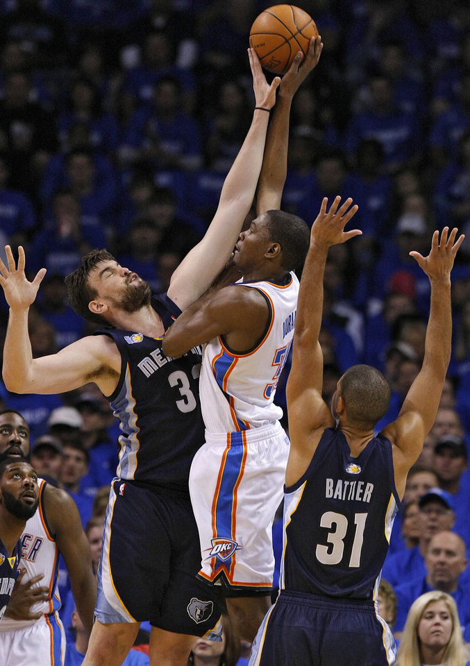Photo - Memphis' Marc Gasol (33) blocks a shot by Oklahoma City's Kevin Durant (35) during game one of the Western Conference semifinals between the Memphis Grizzlies and the Oklahoma City Thunder in the NBA basketball playoffs at Oklahoma City Arena in Oklahoma City, Sunday, May 1, 2011. Photo by Chris Landsberger, The Oklahoman
