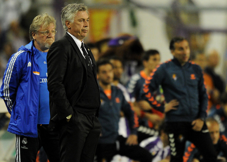 Photo - Real Madrid's manager Carlo Ancelotti reacts,  during a Spanish La Liga soccer match against Real Valladolid,  at the Jose Zorrilla stadium in Valladolid, Spain, Saturday March 8, 2014. (AP Photo/Israel L. Murillo)