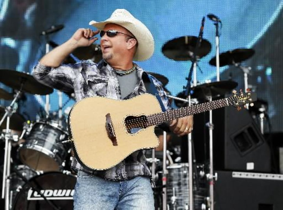 Photo -  Garth Brooks performs during the Oklahoma Twister Relief Concert, benefiting victims of the May tornadoes, at Gaylord Family - Oklahoma Memorial Stadium on the campus of the University of Oklahoma in Norman, Okla., Saturday, July 6, 2013. Photo by Nate Billings, The Oklahoman
