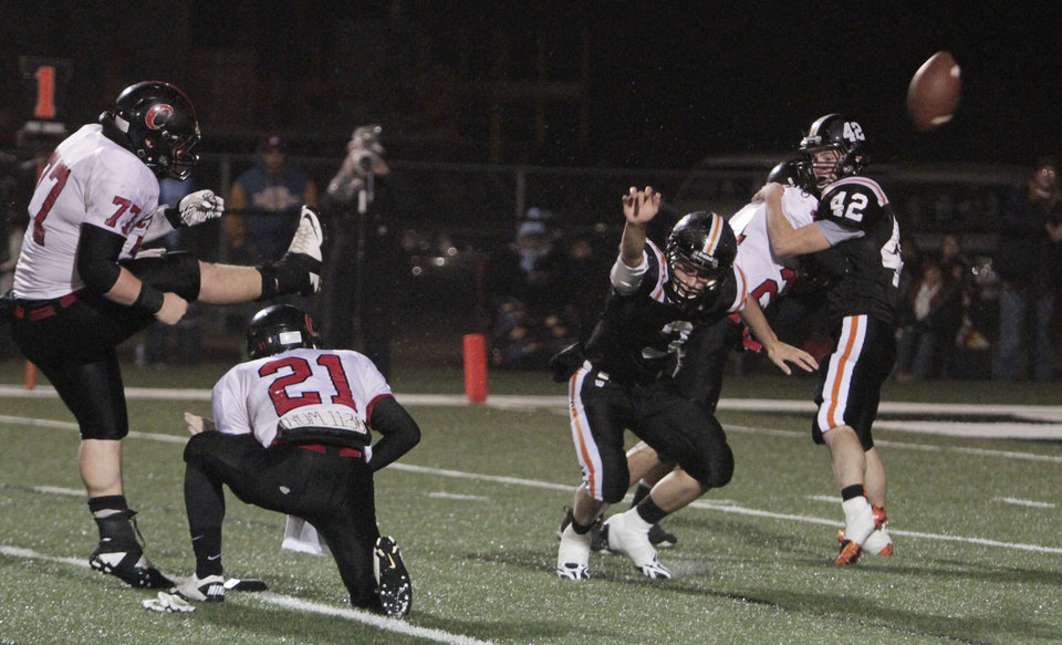Photo - Wayne's Louden Johnson (3) blocks an extra point attempt by Clinton Horn (77)as the Wayne Bulldogs play the Carnegie Wildcats in Class A semifinal of high school football on Friday, Dec. 2, 2011, in Newcastle, Okla.   Photo by Steve Sisney, The Oklahoman