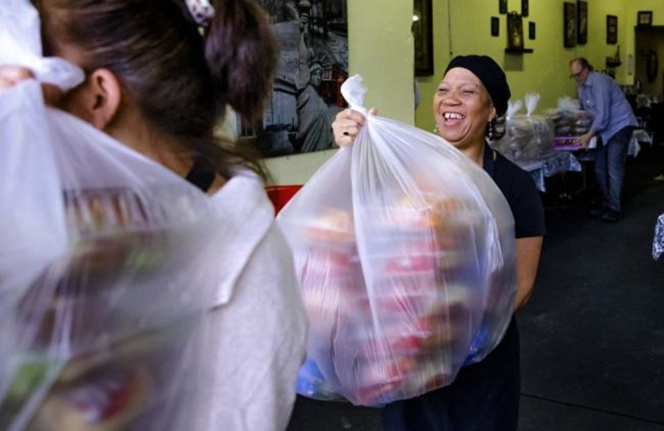 Photo - Donna Heins carries out part of the 200 lunches that she and her staff at Clara Belle's restaurant catered for the staff at Mabel Bassett in McLoud, Okla. on Friday, April 3, 2020. Prison volunteers raised money to pay for lunch boxes for staff at the prison.  [Chris Landsberger/The Oklahoman]