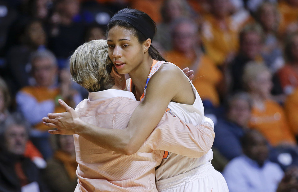 Photo - Tennessee head coach Holly Warlick hugs Isabelle Harrison as Harrison leaves the game late in the second half of an NCAA women's college basketball second-round tournament game against St. John's Monday, March 24, 2014, in Knoxville, Tenn. Tennessee won 67-51. (AP Photo/Mark Humphrey)
