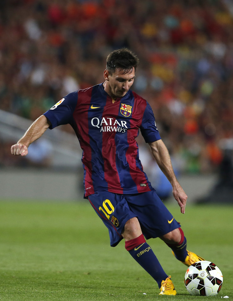 Photo - Barcelona's Lionel Messi, from Argentina, kicks the ball during the Joan Gamper trophy friendly soccer match between Barcelona and Leon at the Camp Nou stadium in Barcelona, Spain, Monday, Aug. 18, 2014. (AP Photo/Emilio Morenatti)