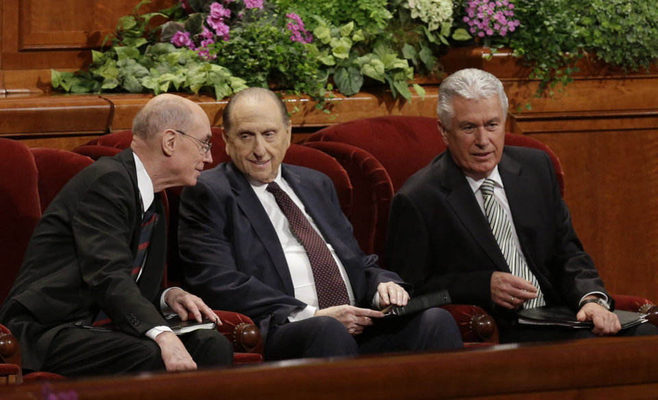 Photo - President Thomas S. Monson, center, and his two counselors, Henry B. Eyring, left, and Dieter F. Uchtdorf, right, talk during the 183rd Annual General Conference of The Church of Jesus Christ of Latter-day Saints Saturday, April 6, 2013, in Salt Lake City. Saturday, April 6, 2013, in Salt Lake City. The Mormon church is planning to build two new temples in Rio de Janeiro and Cedar City, Utah. The faith's president, Thomas S. Monson, announced the new temples on Saturday during the 183rd semi-annual general conference of The Church of Jesus Christ of Latter-day Saints. More than 100,000 members of the church have gathered in Salt Lake City to hear words of inspiration and guidance for daily living from the faith's senior leaders.  (AP Photo/Rick Bowmer)