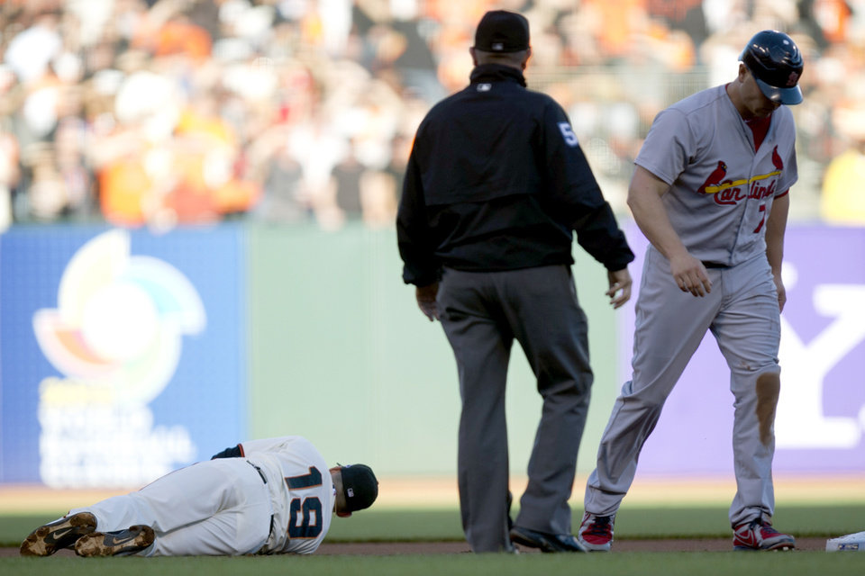 Photo -   San Francisco Giants second baseman Marco Scutaro (19) lies on the infield grass after being knocked down by St. Louis Cardinals' Matt Holliday (7) during Game 2 of baseball's National League championship series, Monday, Oct. 15, 2012, in San Francisco. (AP Photo/The Sacramento Bee, Paul Kitagaki Jr.) MAGS OUT; LOCAL TV OUT (KCRA3, KXTV10, KOVR13, KUVS19, KMAZ31, KTXL40); MANDATORY CREDIT