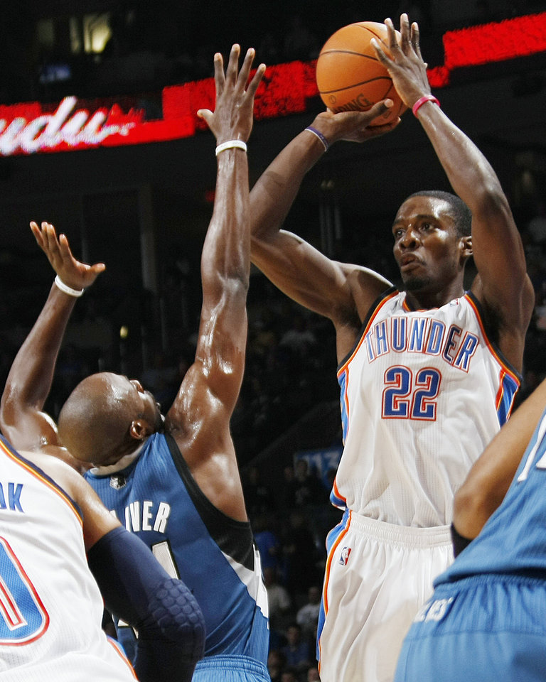 Photo - Oklahoma City's Jeff Green (22) takes a shot over Anthony Tolliver (44) of Minnesota during the NBA basketball game between the Minnesota Timberwolves and the Oklahoma City Thunder at the Oklahoma City Arena, Monday, November 22, 2010, in Oklahoma City. Photo by Nate Billings, The Oklahoman