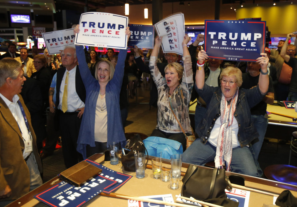Photo - From left, Carol Swink, Pat Grisham and Evelyn McCoy, all from Oklahoma City cheer as Republican Party backers gathered Tuesday night at Main Event Entertainment in northwest Oklahoma City as election returns rolled in the presidential race against Donald Trump and Democrat Hillary Clinton. Oklahomans on Tuesday also cast votes on several state ballot measures, a host of legislative contests and other local issues and offices. Photo by Bryan Terry, The Oklahoman