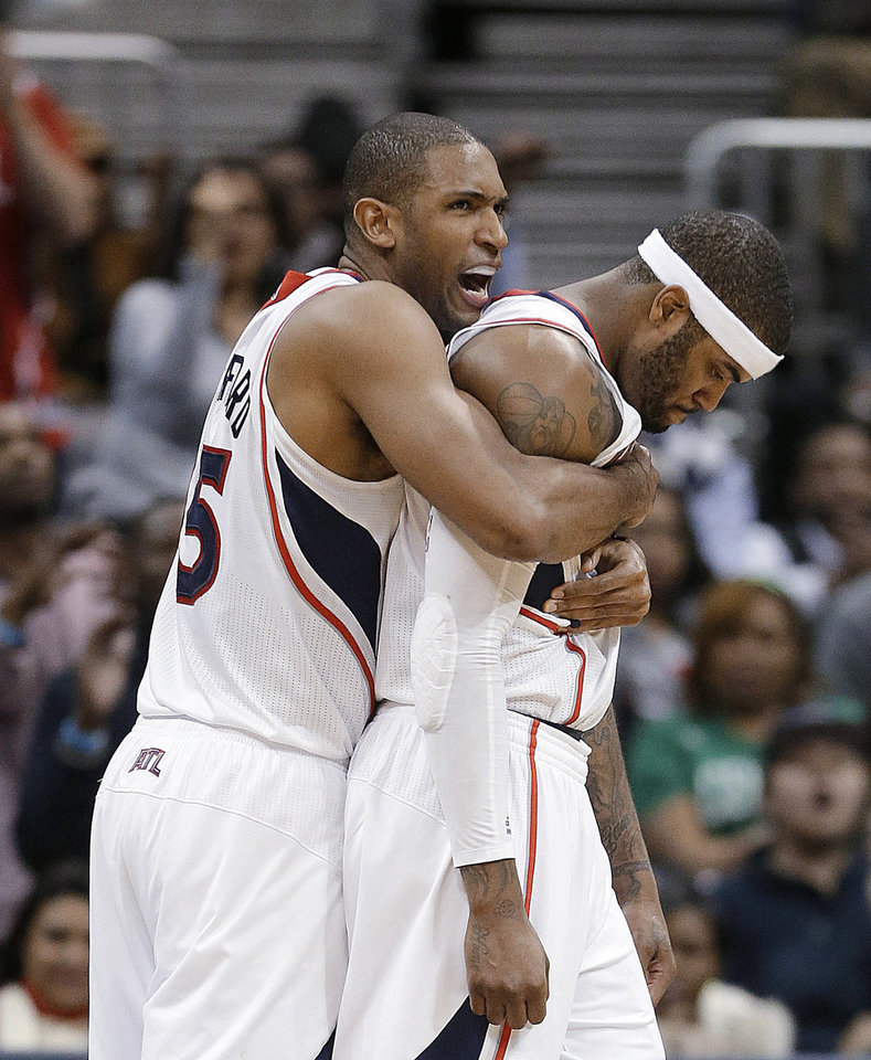 Atlanta Hawks\' Al Horford, left, and Josh Smith react after a Hawks basket in overtime of an NBA basketball game against the Boston Celtics on Friday, Jan. 25, 2013, in Atlanta.Atlanta won 123-111 in double-overtime. (AP Photo/John Bazemore)