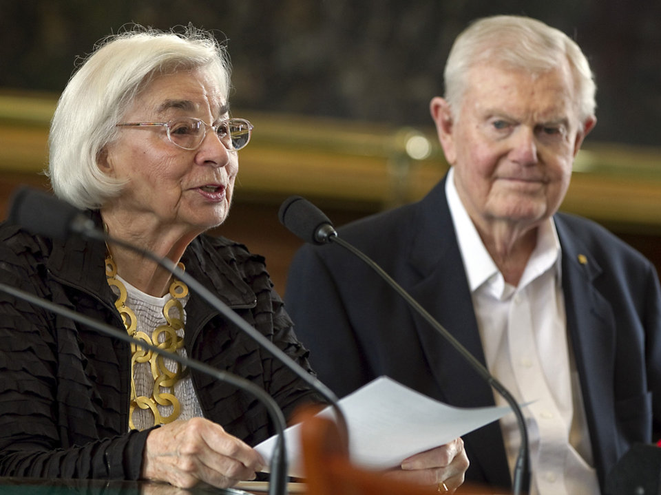 In this photo taken Feb. 28, 2012 , Edith Royal, wife of former Texas football coach Darrell Royal, right, announces that the family foundation named after her husband, DKR Fund for Alzheimer's Research, would fund Alzheimer's disease research in Texas during a joint legislative hearing held at the State Capitol in Austin, Texas. Royal, who won two national championships and turned the Longhorns program into a national power, died early Wednesday, Nov. 7, 2012, at age 88 of complications from cardiovascular disease, school spokesman Bill Little said. Royal also had suffered from Alzheimer\'s disease. (AP Photo/Austin American-Statesman, Rodolfo Gonzalez) MAGS OUT; NO SALES; INTERNET AND TV MUST CREDIT PHOTOGRAPHER AND STATESMAN.COM