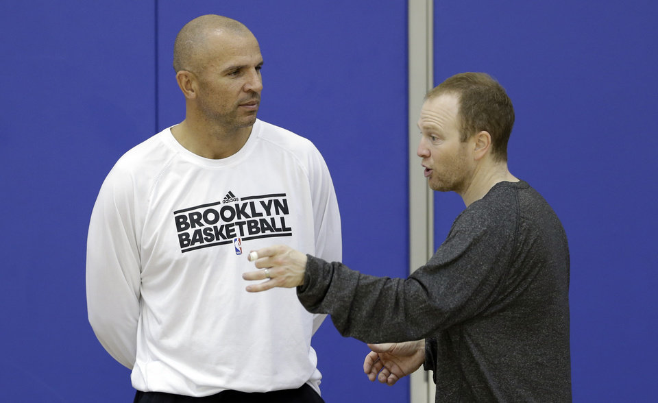 Photo - Brooklyn Nets coach Jason Kidd, left, and assistant coach Lawrence Frank talk during NBA basketball training camp at Duke University in Durham, N.C., Wednesday, Oct. 2, 2013. (AP Photo/Gerry Broome)