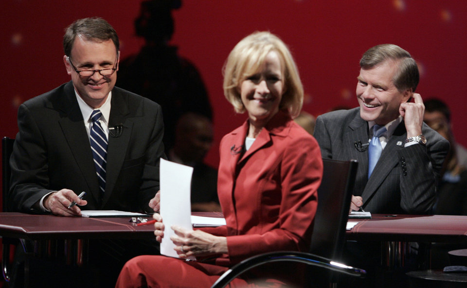 In 2009, Democratic gubernatorial candidate Creigh Deeds, left, and Republican challenger, Bob McDonnell, right, talk with moderator Judy Woodruff, center,  prior to the start of a televised debate sponsored by AARP in Richmond, Va. Woodruff will cover her 10th presidential election as a journalist this year. AP Photo/Steve Helber) <strong>Steve Helber - ASSOCIATED PRESS</strong>
