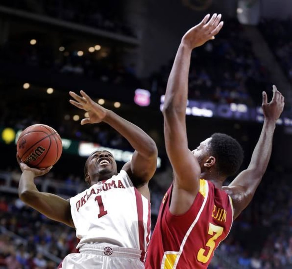 Oklahoma guard Sam Grooms (1) puts up a shot under pressure from Iowa State forward Melvin Ejim (3) during the first half an NCAA college basketball game in the Big 12 Conference tournament Thursday, March 14, 2013, in Kansas City, Mo. (AP Photo/Charlie Riedel)