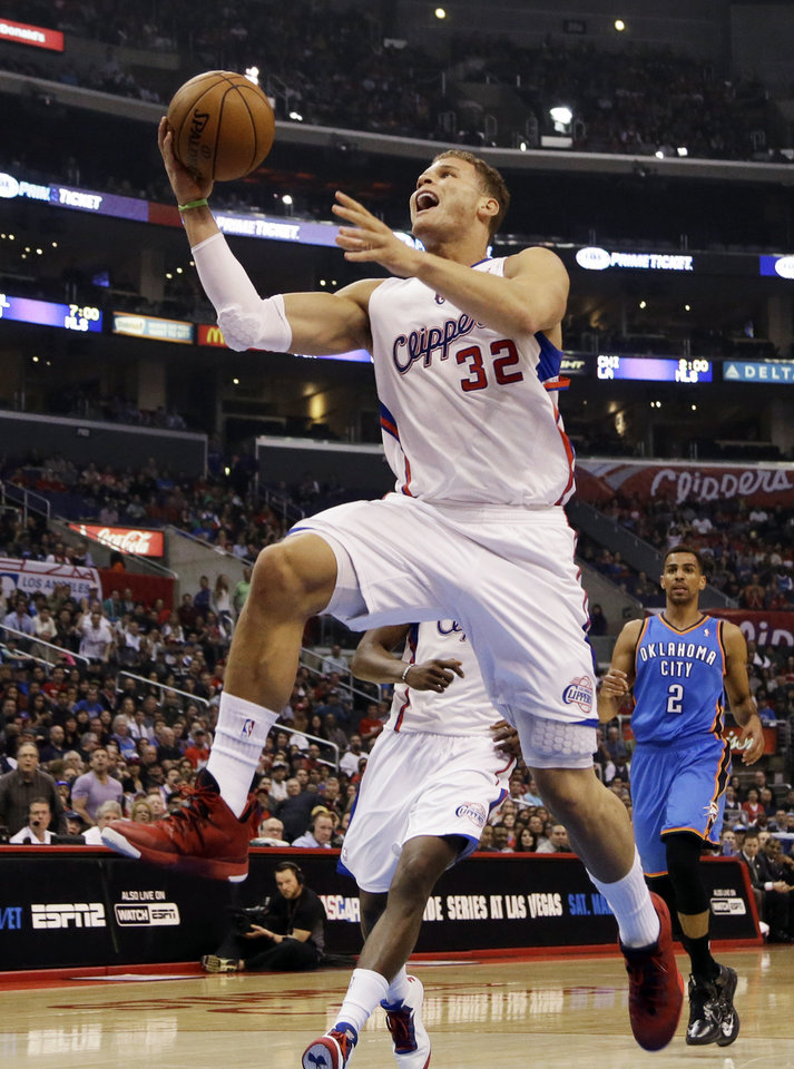 Photo - Los Angeles Clippers forward Blake Griffin (32) shoots against the Oklahoma City Thunder in the first half of an NBA basketball game in Los Angeles, Sunday, March 3, 2013. The Thunder won 108-104. (AP Photo/Reed Saxon) ORG XMIT: LAS108