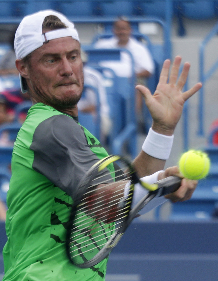 Photo - Lleyton Hewitt, from Australia, hits a forehand during a first-round match against Jurgen Melzer, from Austria, at the Western & Southern Open tennis tournament, Sunday, Aug. 10, 2014, in Mason, Ohio. (AP Photo/Al Behrman)