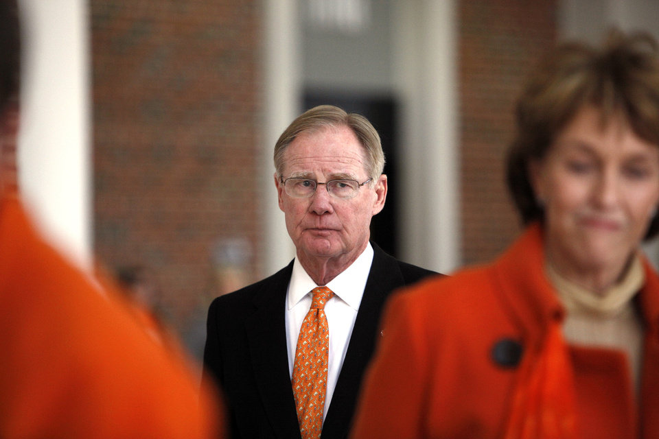 Oklahoma State president Burns Hargis walks toward a memorial banner for women's basketball coach Kurt Budke, assistant coach Miranda Serna at Gallagher- Iba Arena in Stillwater, Okla.,  Friday, Nov. 18, 2011.  Photo by Sarah Phipps, The Oklahoman