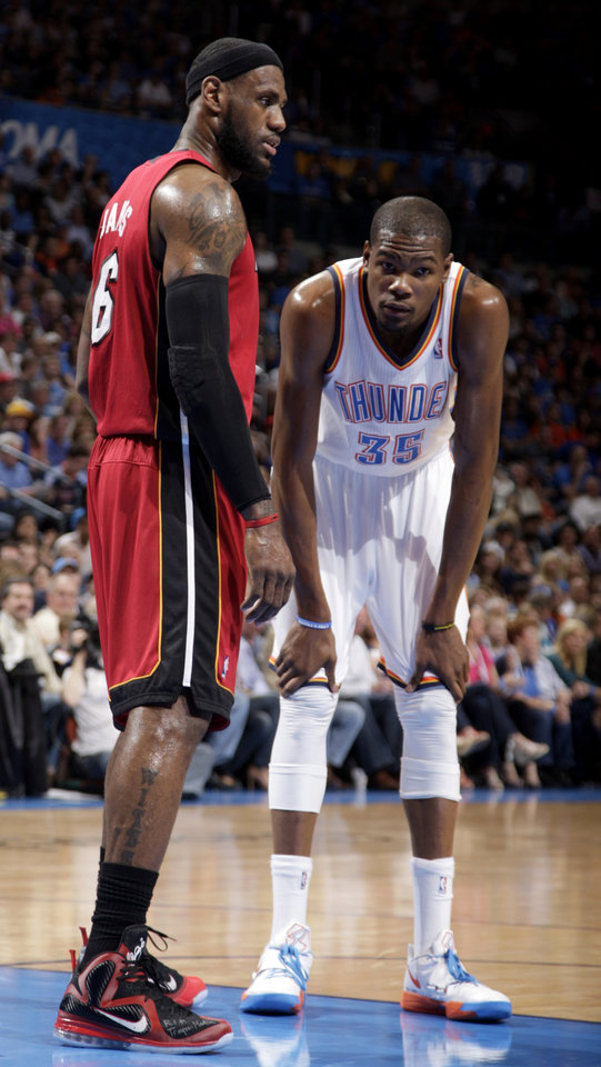 Miami Heat's LeBron James (6) stands next to Oklahoma City Thunder's Kevin Durant (35)  and during the NBA basketball game between the Miami Heat and the Oklahoma City Thunder at Chesapeake Energy Arena in Oklahoma City, Sunday, March 25, 2012. Photo by Sarah Phipps The Oklahoman