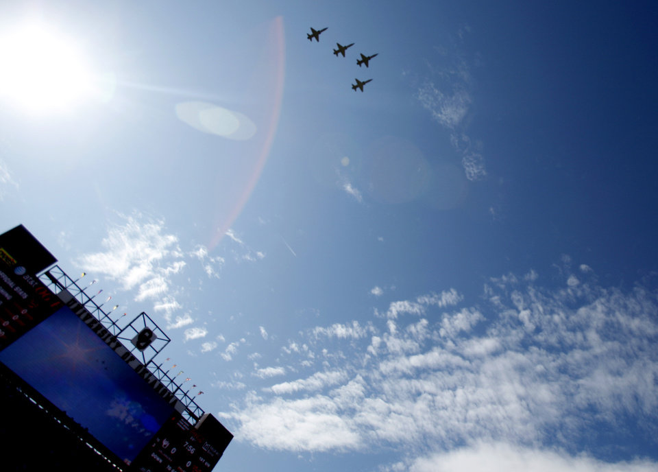 Photo - Jets fly over before the Bedlam college football game between the University of Oklahoma Sooners (OU) and the Oklahoma State University Cowboys (OSU) at the Gaylord Family-Oklahoma Memorial Stadium on Saturday, Nov. 28, 2009, in Norman, Okla. Photo by Sarah Phipps, The Oklahoman