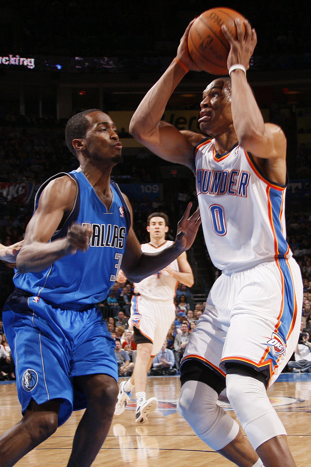 Oklahoma City\'s Russell Westbrook (0) works against Dallas\' Rodrigue Beaubois (3) during the NBA basketball game between the Oklahoma City Thunder and the Dallas Mavericks at Chesapeake Energy Arena in Oklahoma City, Monday, March 5, 2012. Photo by Nate Billings, The Oklahoman