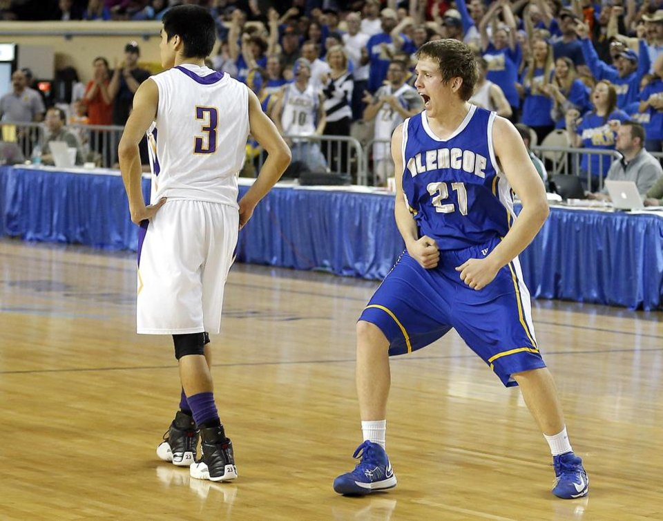 Photo -  Glencoe's Hunter Hall celebrates in front of Weleetka's Shaun Bencoma following the Class A boys state championship between Glencoe and Weleetka  at the State Fair Arena., Friday, March 1, 2013. Photo by Sarah Phipps, The Oklahoman