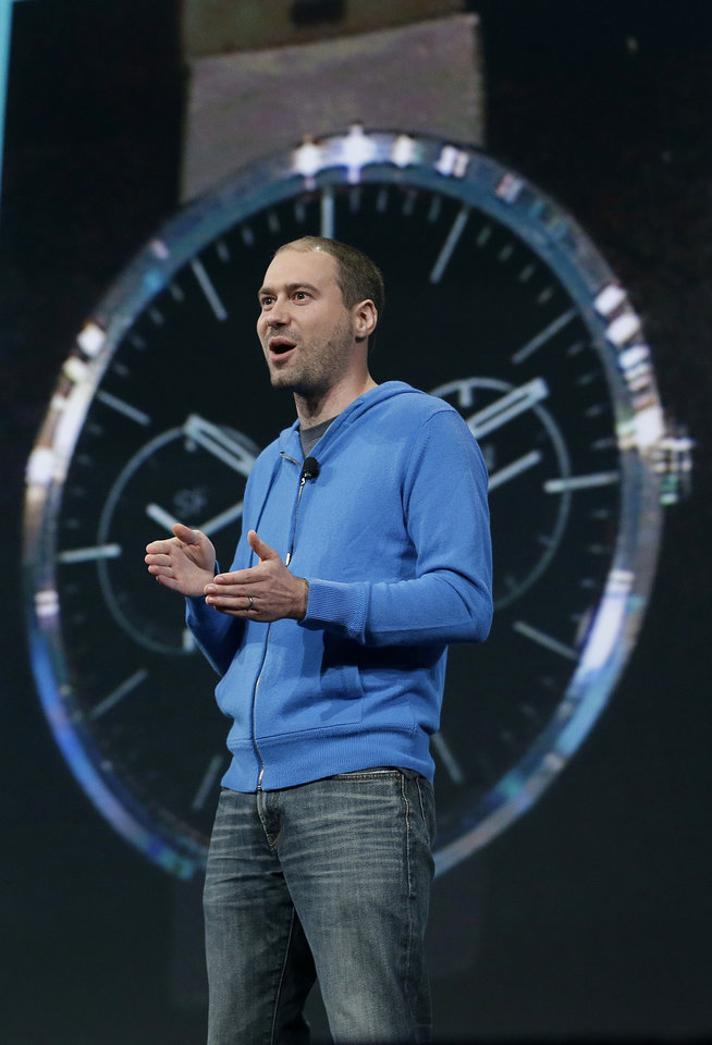 Photo - David Singleton, Android director of engineering, speaks about Android Wear at the Google I/O 2014 keynote presentation in San Francisco, Wednesday, June 25, 2014. As the Internet giant's Android operating system stretches into cars, homes and smartwatches, this year's annual confab will expand on its usual focus on smartphones and tablets. (AP Photo/Jeff Chiu)