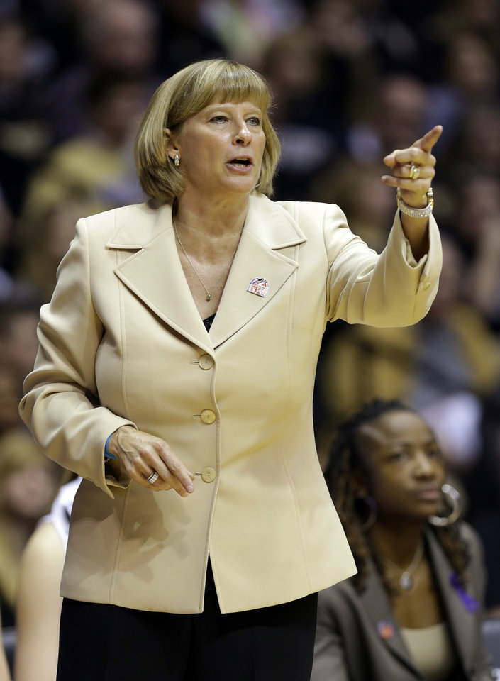 Photo - Purdue head coach Sharon Versyp calls a play for her team as they played Akron during the first half of a first-round game in the NCAA women's college basketball tournament, Saturday, March 22, 2014, in West Lafayette, Ind. (AP Photo/Michael Conroy)