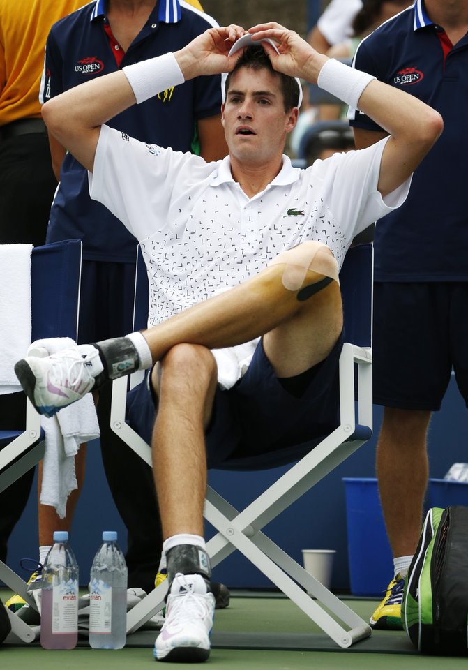 Photo - John Isner, of the United States, takes a break between games against Philipp Kohlschreiber, of Germany, during the third round of the 2014 U.S. Open tennis tournament, Saturday, Aug. 30, 2014, in New York. (AP Photo/Kathy Willens)