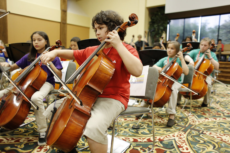 Photo -  Joe Effinger plays his instrument during the El Sistema Oklahoma youth orchestra's last concert of the school year at St. Luke's United Methodist Church, 222 NW 15. At Joe's left is Leah White. Photo by Doug Hoke, The Oklahoman   DOUG HOKE -