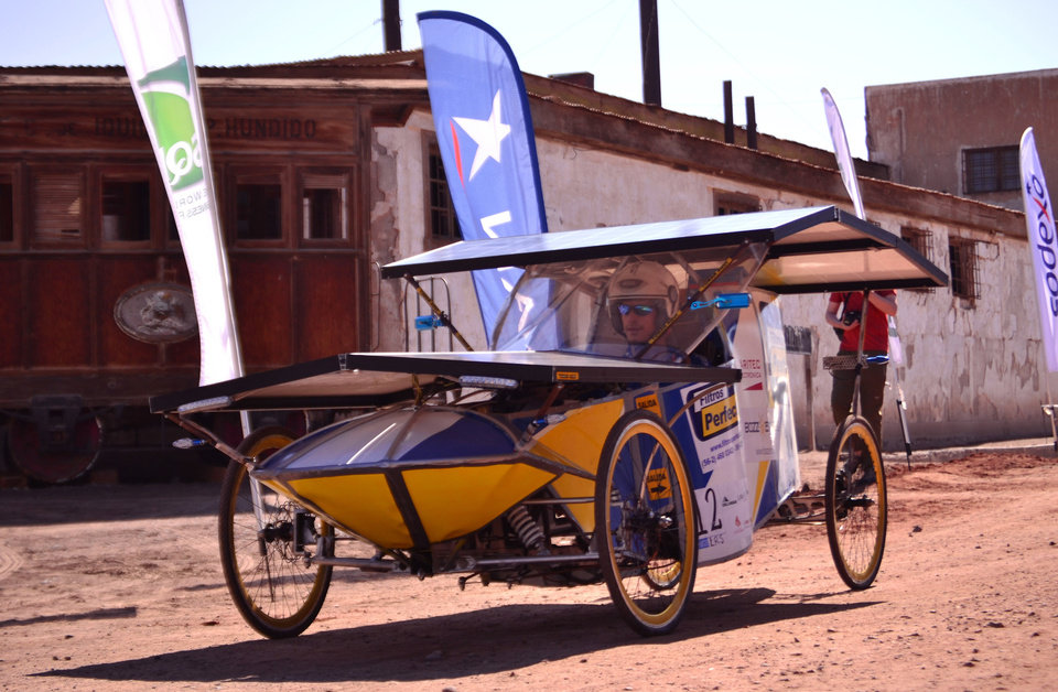 Photo -   In this photo released by Carrera Solar Atacama 2012, a driver sits in his solar powered car from the team BozzEnergy at the start of the first phase of a race, in Humberstone in the area of Pozo Almonte, Chile, Thursday, Nov. 15, 2012. Most participants belong to universities and one entry rule stipulates that cars cannot cost more then $7,000 dollars. (AP Photo/Carrera Solar Atacama 2012)