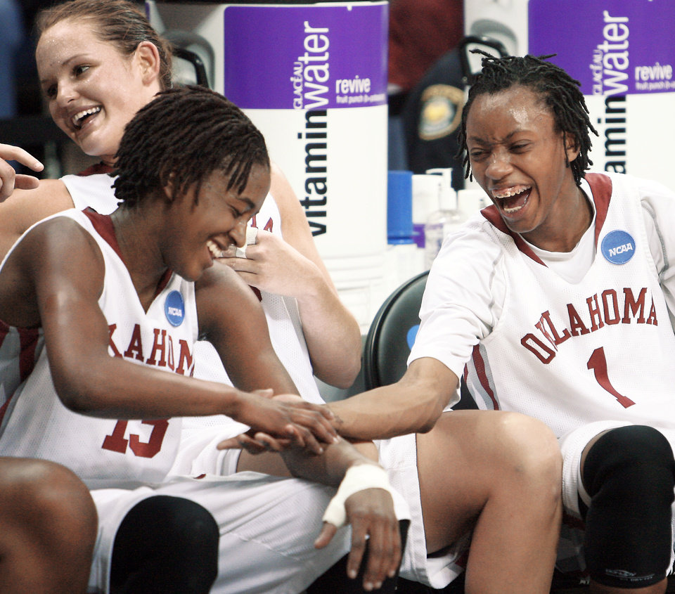 Photo - Danielle Robinson, left, and Nyeshia Stevenson celebrate their NCAA Tournament win over Georgia Tech. The Sooners are headed back to Ford Center for the NCAA Regional semifinals. PHOTO BY STEVE SISNEY, THE OKLAHOMAN