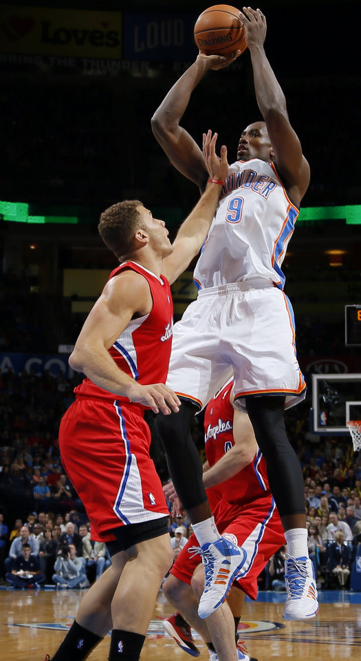 Oklahoma City's Serge Ibaka shoots the ball over Blake Griffin of the Clippers during an NBA basketball game between the Oklahoma City Thunder and the Los Angeles Clippers at Chesapeake Energey Arena in Oklahoma City, Sunday, Nov. 3, 2013. Photo by Bryan Terry, The Oklahoman