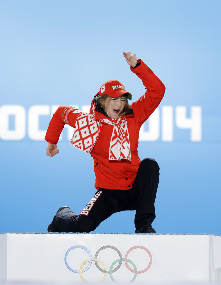 Photo - Women's biathlon 15K individual gold medalist Darya Domracheva of Belarus celebrates during the medals ceremony at the 2014 Winter Olympics, Saturday, Feb. 15, 2014, in Sochi, Russia. (AP Photo/David J. Phillip, File)