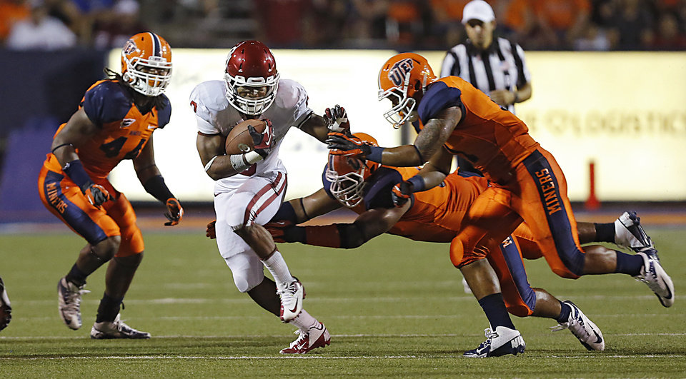 Photo - Oklahoma Sooners running back Dominique Whaley (8) makes his way through the UTEP defense during the college football game between the University of Oklahoma Sooners (OU) and the University of Texas El Paso Miners (UTEP) at Sun Bowl Stadium on Saturday, Sept. 1, 2012, in El Paso, Tex.  Photo by Chris Landsberger, The Oklahoman