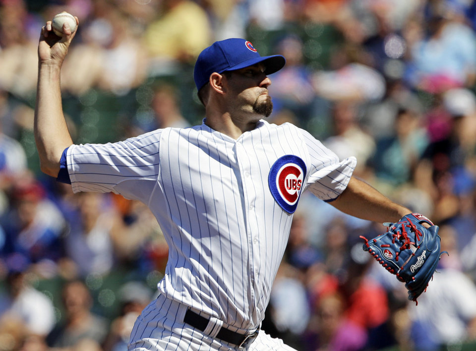 Photo - Chicago Cubs starter Jason Hammel throws against the Miami Marlins during the first inning of a baseball game in Chicago, Friday, June 6, 2014. (AP Photo/Nam Y. Huh)