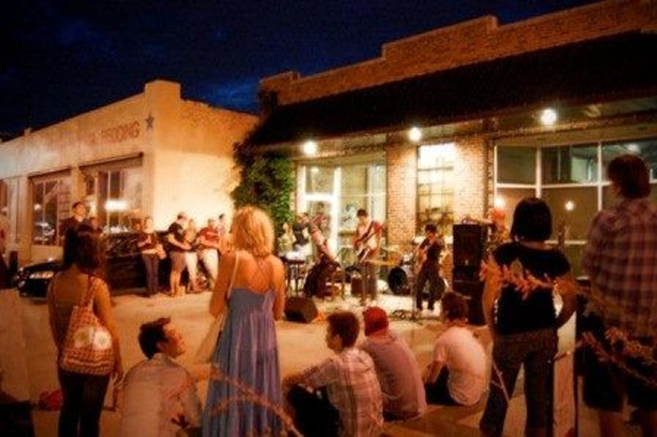 A crowd gathers outside to listen to a band in the Plaza District, a revitalized stretch of NW 16 between Classen Drive and Pennsylvania Avenue. The area has become an Oklahoma City arts center, hosting frequent outdoor events. Photos provided