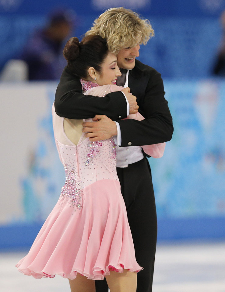 Photo - Meryl Davis and Charlie White of the United States compete in the ice dance short dance figure skating competition at the Iceberg Skating Palace during the 2014 Winter Olympics, Sunday, Feb. 16, 2014, in Sochi, Russia. (AP Photo/Vadim Ghirda)