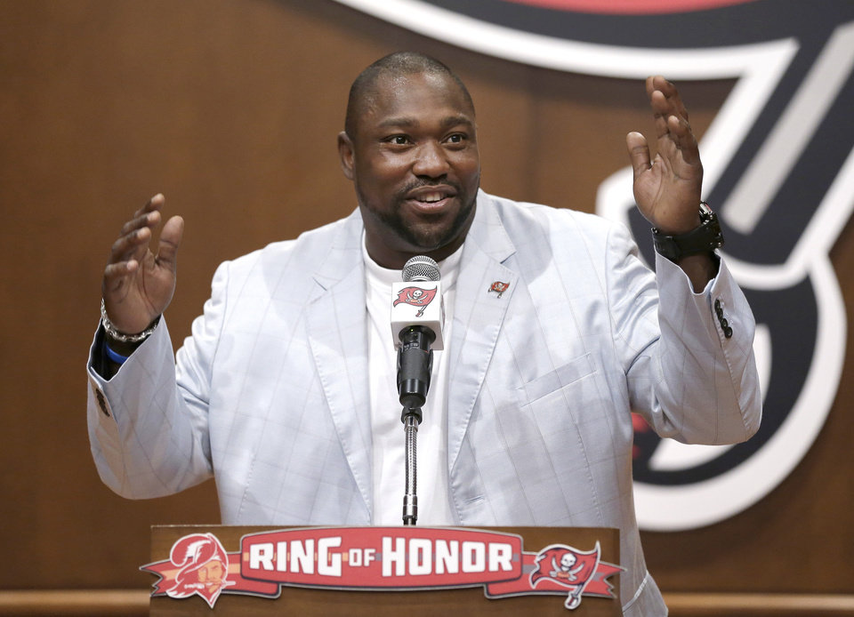 Former Tampa Bay Buccaneers defensive tackle Warren Sapp gestures while being inducted into the Buccaneers' Ring of Honor Thursday, May 2, 2013, in Tampa, Fla. (AP Photo/Chris O'Meara)