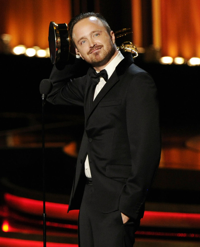 "Photo - Aaron Paul accepts the award for outstanding supporting actor in a drama series for his work on ""Breaking Bad"" at the 66th Annual Primetime Emmy Awards at the Nokia Theatre L.A. Live on Monday, Aug. 25, 2014, in Los Angeles. (Photo by Chris Pizzello/Invision/AP)"