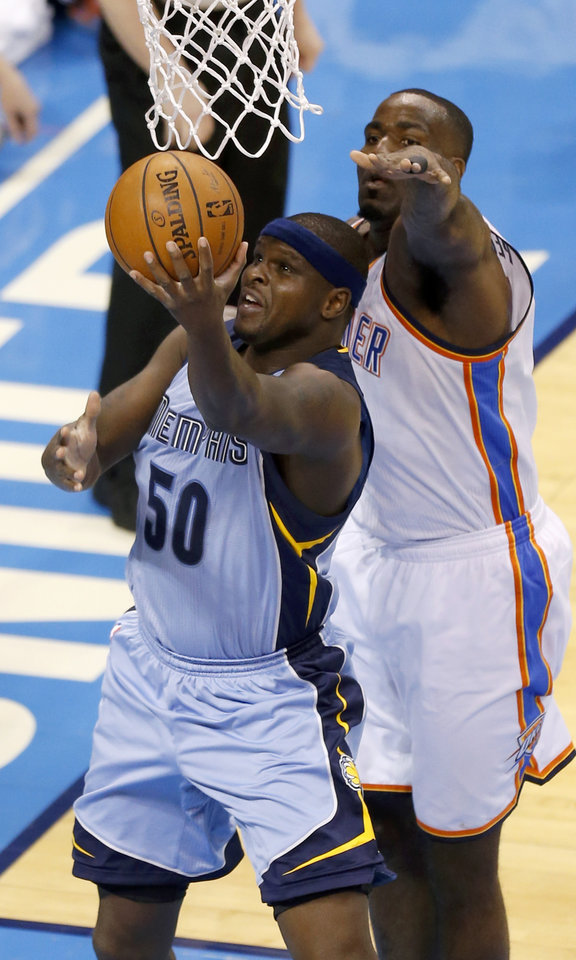 Photo - Memphis' Zach Randolph (50) goes to the basket past Oklahoma City's Kendrick Perkins (5) during Game 5 in the first round of the NBA playoffs between the Oklahoma City Thunder and the Memphis Grizzlies at Chesapeake Energy Arena in Oklahoma City, Tuesday, April 29, 2014. Photo by Nate Billings, The Oklahoman