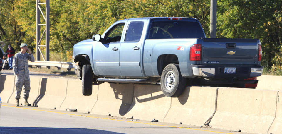 A pickup truck straddles the divider wall on southbound I-235 just south of I-44 Thursday, Nov. 4, 2010, just west of where a semi truck overturned on an exit ramp from I-44 onto northbound Broadway Extension in Oklahoma City. Photo by Paul B. Southerland, The Oklahoman